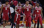Arkansas players break a huddle during a game against Tennessee on Wednesday, Jan. 6, 2021, in Knoxville, Tenn. (Randy Sartin/USA TODAY Sports via Pool)
