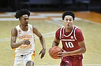 Arkansas' Jaylin Williams (10) heads to the basket while pursued by Tennessee's Keon Johnson (45) during an NCAA college basketball game Wednesday, Jan. 6, 2021, in Knoxville, Tenn. (Saul Young/Knoxville News Sentinel via AP, Pool)