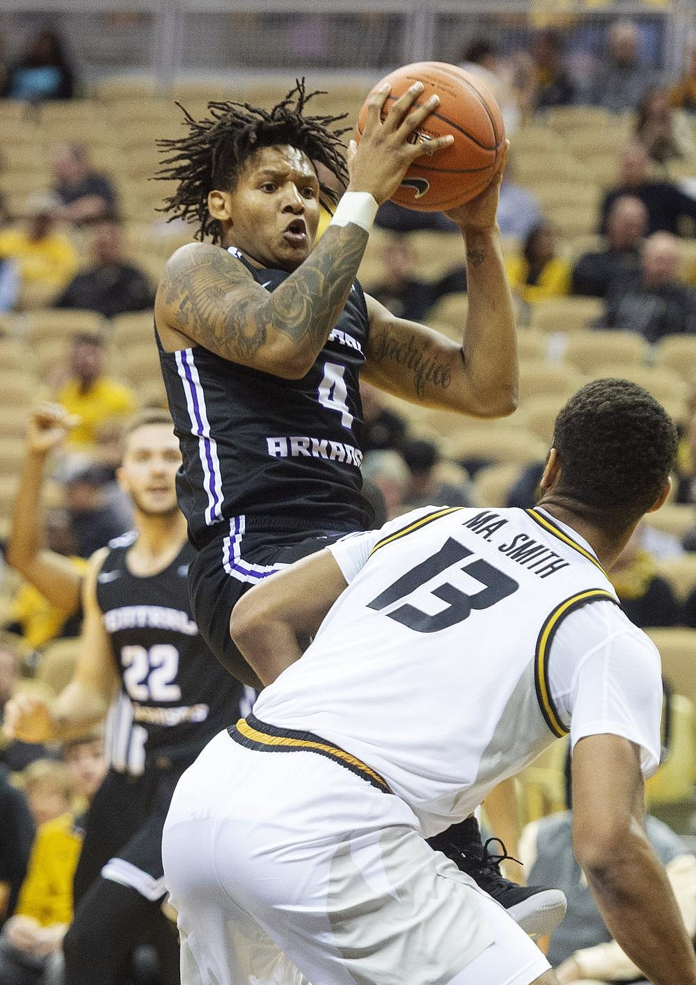 Khaleem Bennett (shown, 4), back with the University of Central Arkansas after having to redshirt in 2019-20 following offseason surgery for a broken foot, had 21 points to help the Bears defeat New Orleans.  (AP/L.G. Patterson)