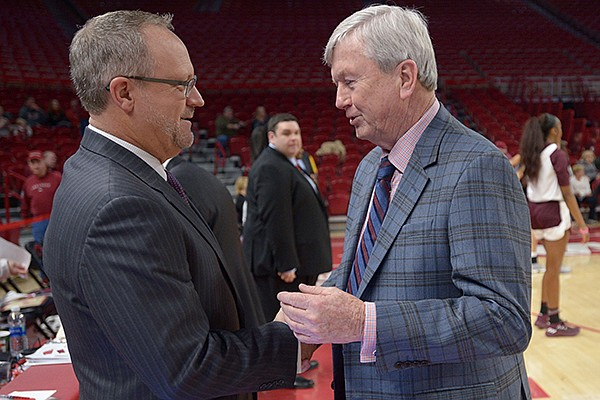 Arkansas coach Mike Neighbors (left) shares a laugh with Texas A&M coach Gary Blair Thursday, Feb. 22, 2018, before their game in Bud Walton Arena.
