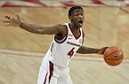 Arkansas guard Davonte Davis (4) runs a play against Georgia during the second half of an NCAA college basketball game Saturday, Jan. 9, 2021, in Fayetteville. (AP Photo/Michael Woods)