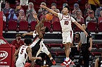 Arkansas defender Jaylin Williams (10) blocks the shot of Georgia's Tye Fagan (14) during the second half of an NCAA college basketball game Saturday, Jan. 9, 2021, in Fayetteville. (AP Photo/Michael Woods)