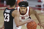 Arkansas' Moses Moody (5) guards Georgia's Mikal Starks (23) during a game Saturday, Jan. 9, 2021, in Fayetteville.