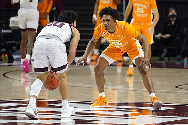 Tennessee guard Keon Johnson (45) guards Texas A&M guard Andre Gordon (20) during the first half of an NCAA college basketball game Saturday, Jan. 9, 2021, in College Station, Texas. (AP Photo/Sam Craft)