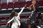 Arkansas' Erynn Barnum tries to block a shot by Texas A&M's Aaliyah Wilson on Sunday, Jan. 10, 2021, at Bud Walton Arena in Fayetteville. Arkansas lost 74-73. Visit nwaonline.com/210111Daily/ and nwadg.com/photos.