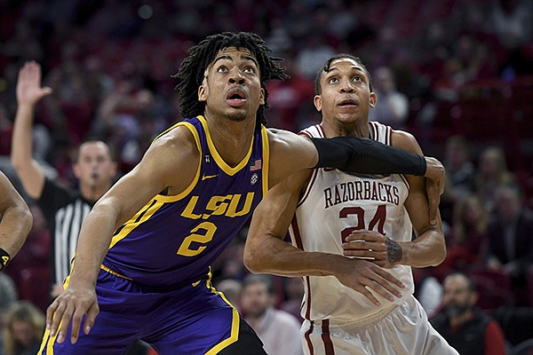 LSU's Trendon Watford (2) and Arkansas' Ethan Henderson (24) fight for position during the first half of an NCAA college basketball game Wednesday, March 4, 2020, in Fayetteville. (AP Photo/Michael Woods)