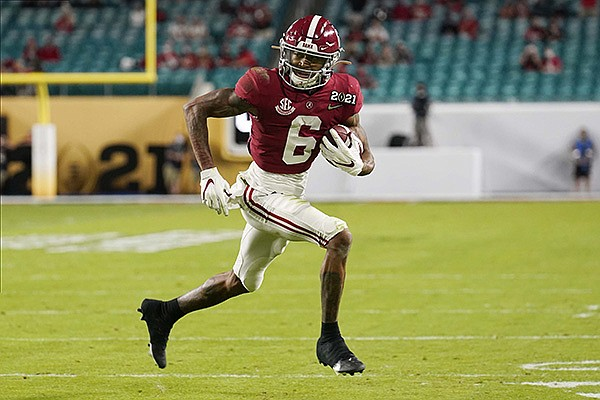 Alabama wide receiver DeVonta Smith runs for a touchdown against Ohio State during the first half of an NCAA College Football Playoff national championship game, Monday, Jan. 11, 2021, in Miami Gardens, Fla. (AP Photo/Chris O'Meara)