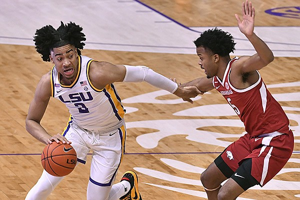 LSU forward Trendon Watford (2) drives past Arkansas guard Moses Moody (5) during the first half of an NCAA college basketball game Wednesday, Jan. 13, 2021, in Baton Rouge, La. (Hilary Scheinuk/The Advocate via AP)
