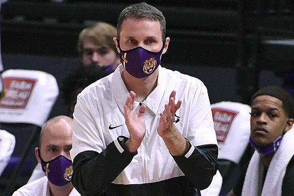 LSU head coach Will Wade looks on during the first half of an NCAA college basketball game against Arkansas Wednesday, Jan. 13, 2021, in Baton Rouge, La. (Hilary Scheinuk/The Advocate via AP)
