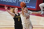 Arkansas' Amber Ramirez shoots in front of Missouri's Lauren Hansen Sunday Jan. 3, 2021 at Bud Walton Arena in Fayetteville. Arkansas won 91-88.