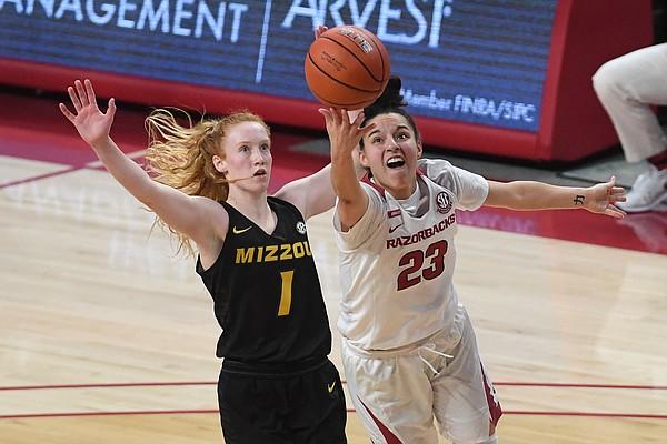 Arkansas' Amber Ramirez shoots in front of Missouri's Lauren Hansen Sunday Jan. 3, 2021 at Bud Walton Arena in Fayetteville. Arkansas won 91-88.