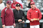 Arkansas-Little Rock coach Chris Curry (left), home plate umpire Jason Blackburn (center) and Arkansas coach Dave Van Horn are shown prior to a game Tuesday, April 2, 2019, in Fayetteville.