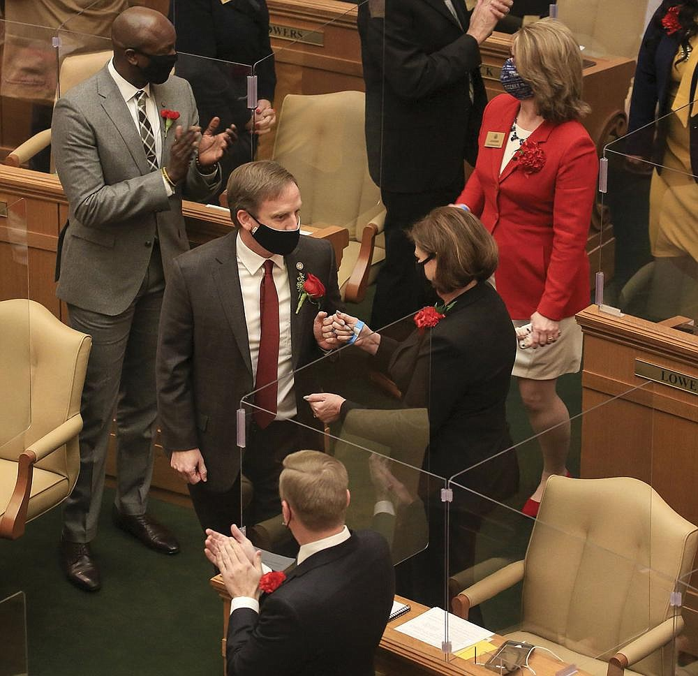 Speaker of the House Rep. Matthew Shepherd, left, R-El Dorado, greats fellow House members Monday Jan. 11, 2021 at the state Capitol in Little Rock as he arrives to be sworn in on the first day of the legislative session.  (Arkansas Democrat-Gazette/Staton Breidenthal)