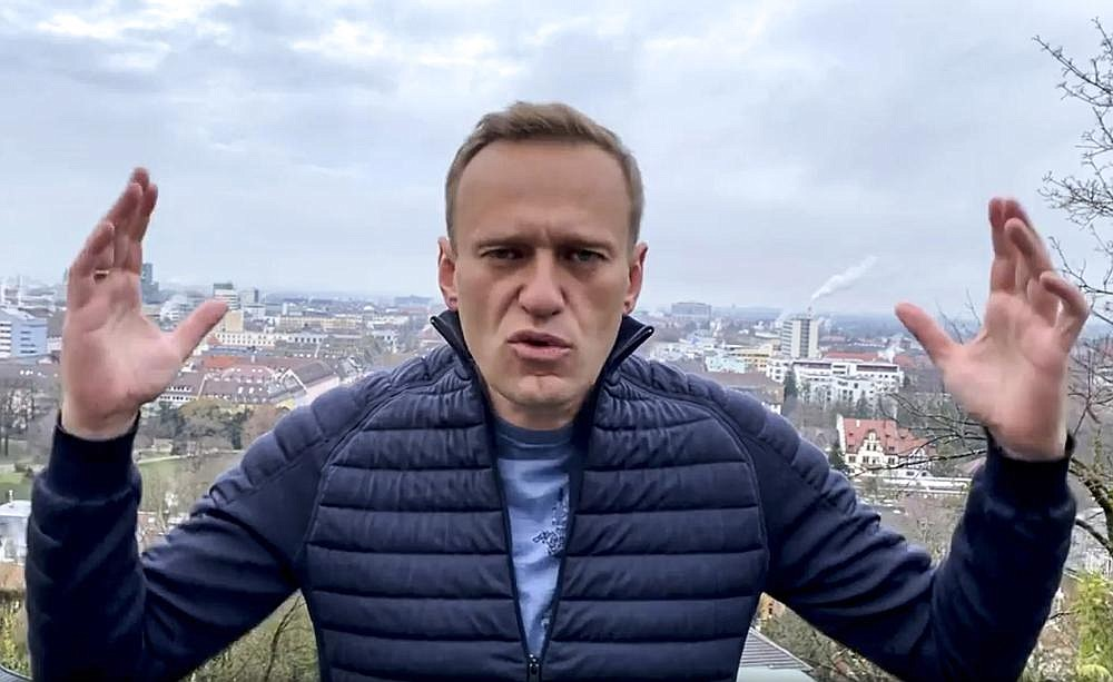 Russian opposition activist Alexei Navalny records a video address Wednesday in Germany, announcing that he will fly home to Russia over the weekend despite opposition from the Kremlin.
