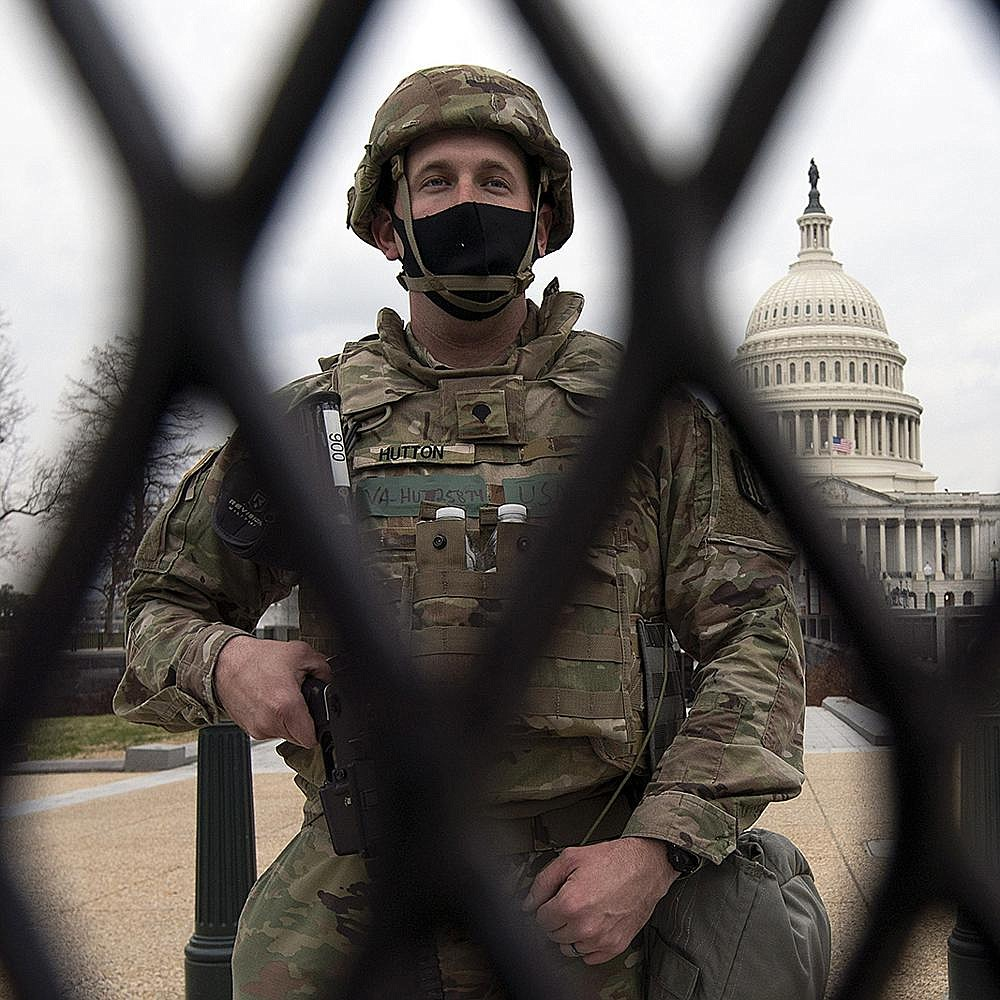 This National Guardsman is among thousands standing watch Friday at the U.S. Capitol, where security has ramped up since a mob stormed the Capitol last week and ahead of Joe Biden's inauguration Wednesday. More photos at arkansasonline.com/116dcguard/. (AP/Jose Luis Magana)
