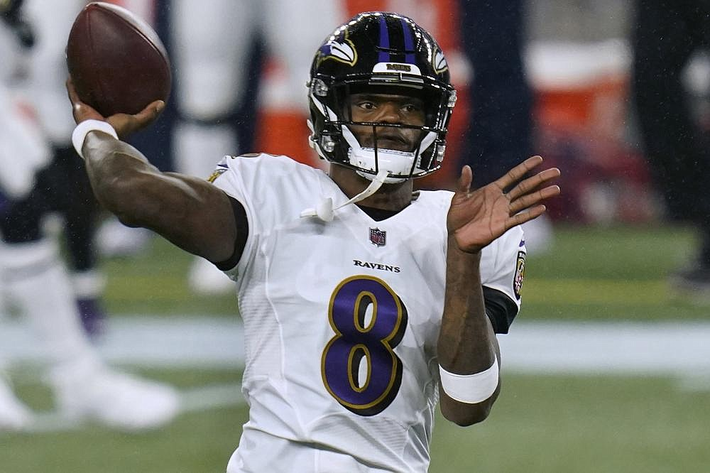 Baltimore Ravens quarterback Lamar Jackson warms up before an NFL football game against the New England Patriots, Sunday, Nov. 15, 2020, in Foxborough, Mass. (AP Photo/Charles Krupa)