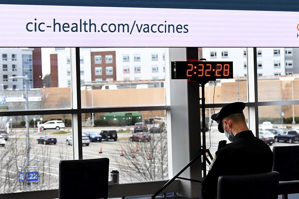 Police officer Brendan Fayles relaxes Friday after receiving the Moderna vaccine at the Putnam Clubhouse at Gillette Stadium in Foxboro, Mass., the first large-scale vaccination site for the coronavirus in Massachusetts.