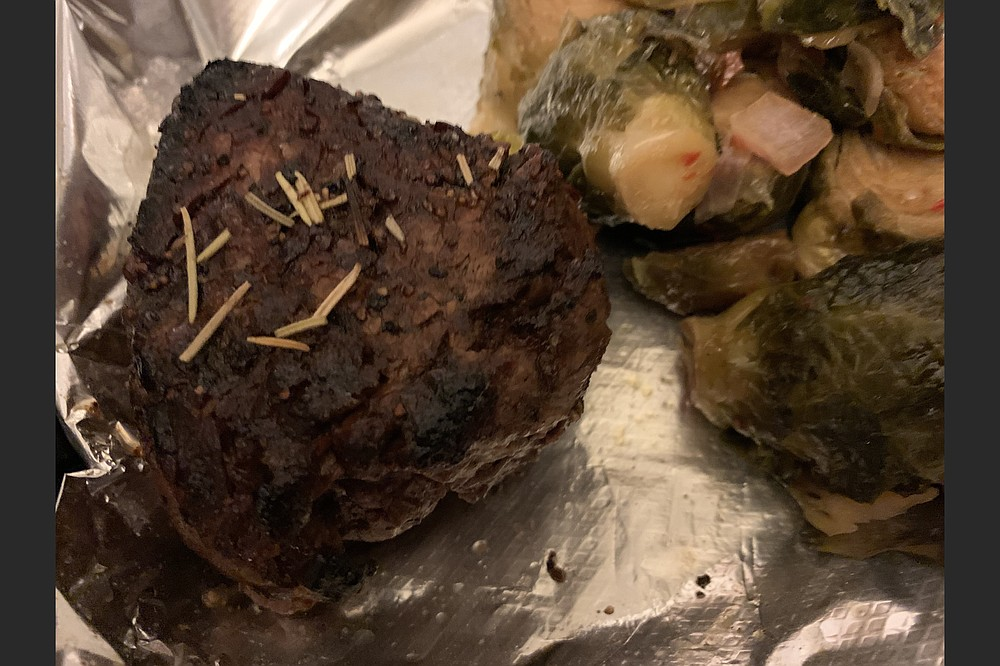 Bone's Chophouse's 6-ounce center cut filet, with brussels sprouts on the side, was just as good for a take-out order as it was in the restaurant. (Arkansas Democrat-Gazette/Eric E. Harrison)