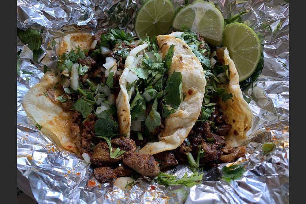 Three tacos al pastor made for a tasty Tuesday treat from Taqueria y Carniceria Guadalajara in North Little Rock. (Arkansas Democrat-Gazette/Eric E. Harrison)