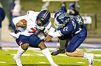 Marion quarterback Daedrick Cail (7) is sacked by Greenwood defender Jordan Hanna during a game Friday, Nov. 27, 2020, in Greenwood.
