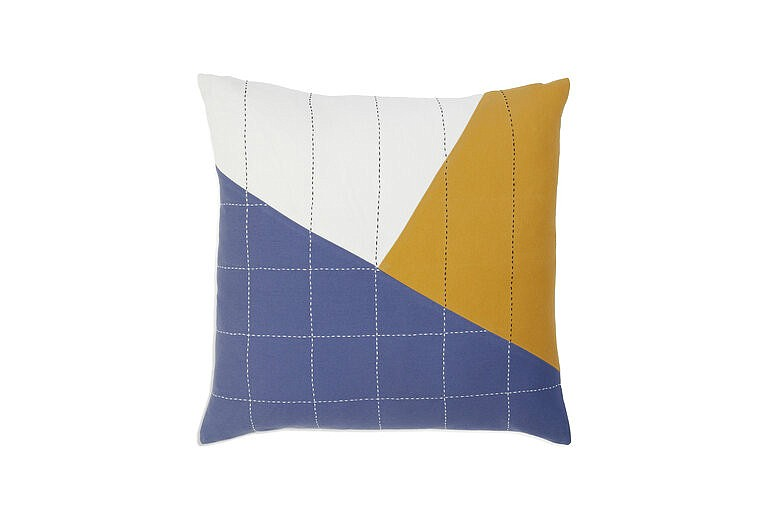 This image provided by Brooklinen shows a Anchal pillow. Artist, Colleen Clines, went to India while attending the Rhode Island School of Design; working with textiles with women there inspired her to found the non-profit Anchal Project with her sister Maggie. They now employ over 150 artisans in India as well as in their native Louisville, Kentucky. (Brooklinen via AP)