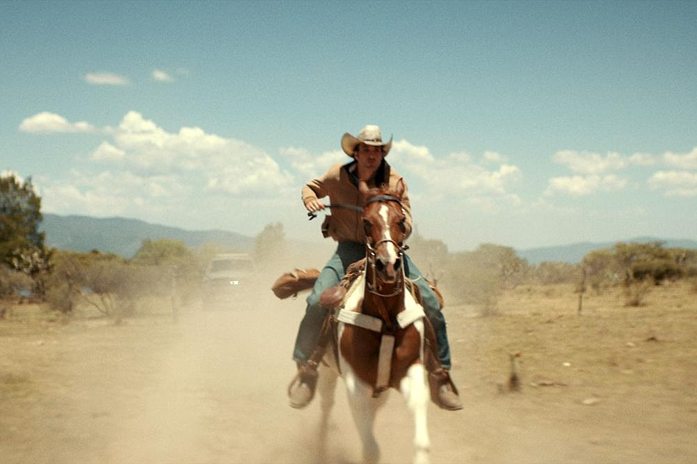 "Wanted man Jackson Greer (Jake Allyn) rides his pony Sundance across the Rio Grande and deep into Mexico to elude a stubborn Texas Ranger in ""No Man's Land."""