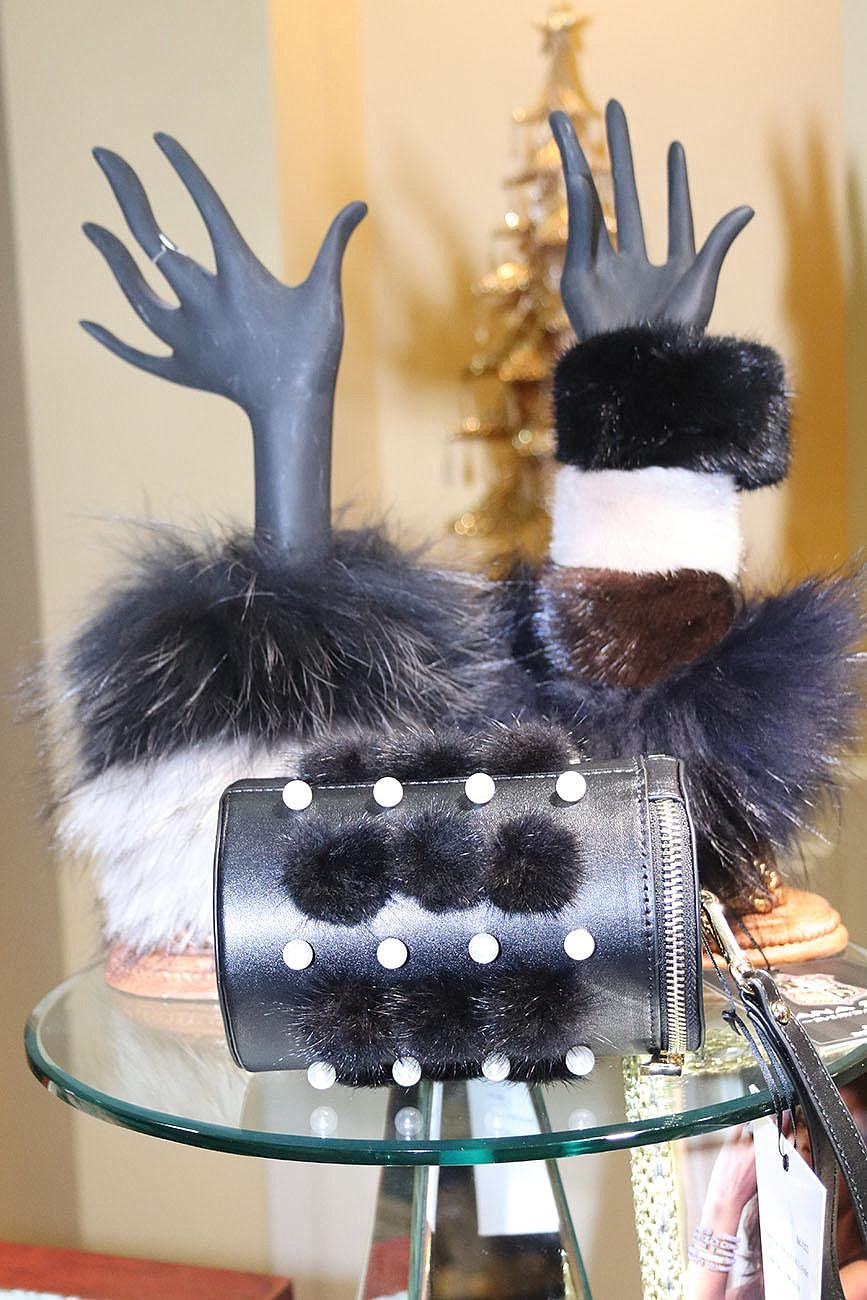 Fur cuffs by Dana Stein tower on hand mannequins over a fur-studded handbag at Powder & Smoke. The potential Valentine's Day gifts are perfect for showing off one's hands at those Zoom meetings.