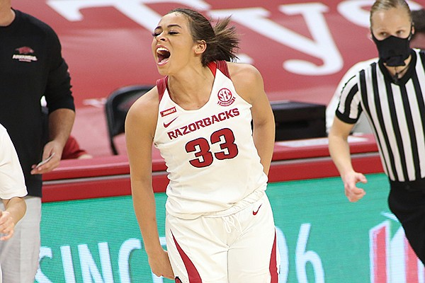 Arkansas guard Chelsea Dungee (33) celebrates a basket during a game against UConn on Thursday, Jan. 28, 2021, in Fayetteville.