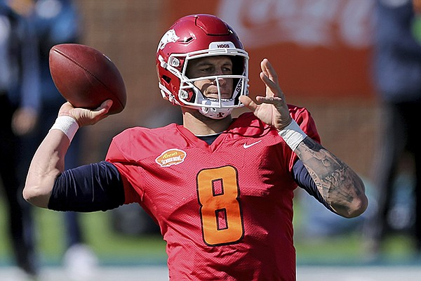 Quarterback Feleipe Franks of Arkansas (8) passes the ball during the National team practice for the NCAA college football Senior Bowl in Mobile, Ala, Thursday, Jan. 28, 2021. (AP Photo/Rusty Costanza)