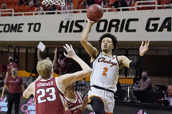 Oklahoma State guard Cade Cunningham (2) shoots over Arkansas forward Connor Vanover (23) in the second half of an NCAA college basketball game, Saturday, Jan. 30, 2021, in Stillwater, Okla. (AP Photo/Sue Ogrocki)