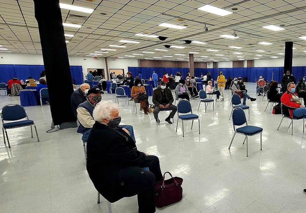 Jefferson County residents, 70 years and older, sit in the 15-minute observation area after receiving their covid-19 vaccinations.  (Pine Bluff Commercial/Eplunus Colvin)