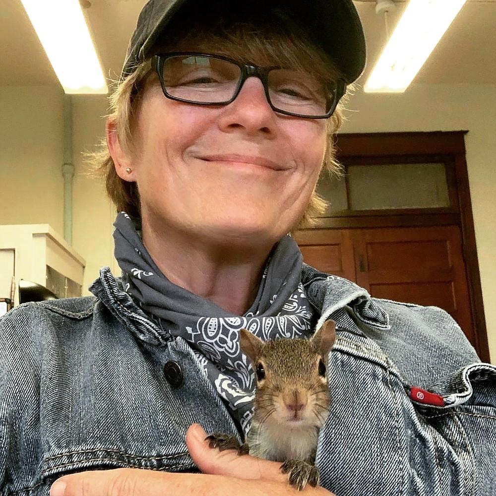 V.L. Cox and her pet squirrel, J.D.