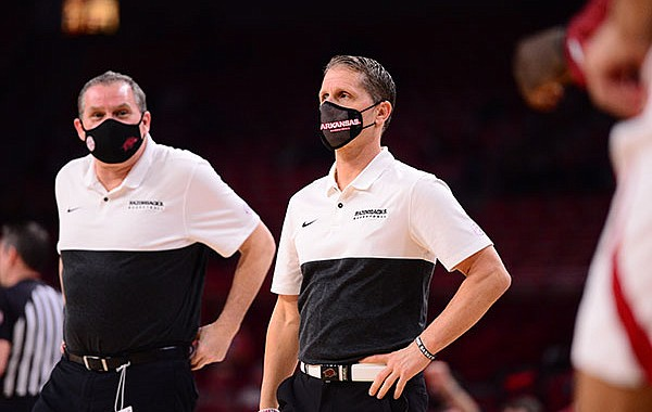 Arkansas coach Eric Musselman (right) and assistant Clay Moser are shown during a game against Mississippi State on Tuesday, Feb. 2, 2021, in Fayetteville.