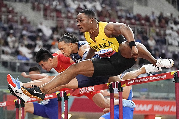Omar Mcleod, of Jamaica, competes in the men's 110 meter hurdles semifinal at the World Athletics Championships in Doha, Qatar, Wednesday, Oct. 2, 2019. (AP Photo/David J. Phillip)