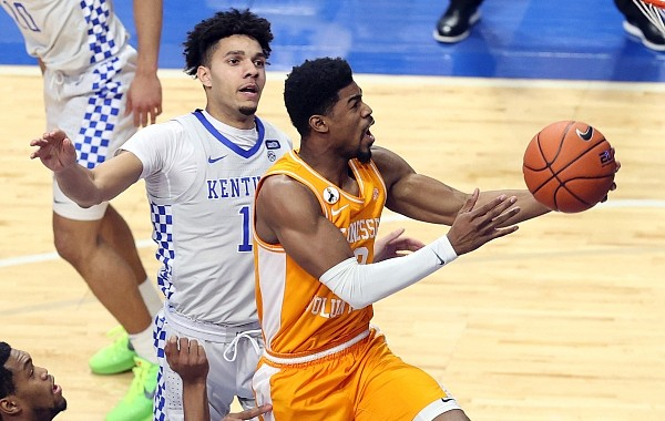 Tennessee's Victor Bailey Jr., right, shoots in front of Kentucky's Dontaie Allen during the first half of an NCAA college basketball game in Lexington, Ky., Saturday, Feb. 6, 2021. (AP Photo/James Crisp)