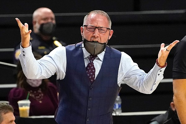 Texas A&M head coach Buzz Williams reacts against Missouri during the first half of an NCAA college basketball game Saturday, Jan. 16, 2021, in College Station, Texas. (AP Photo/Sam Craft)