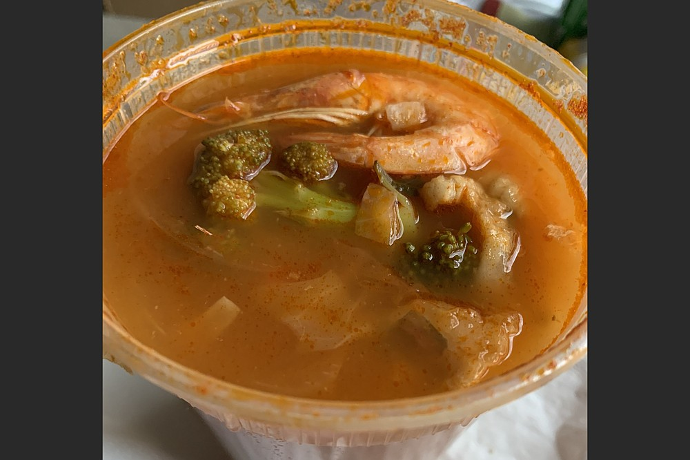 We found fish, shrimp, crab, more fish, calamari and mussels in our Sietes Mares (Seven Seas) soup from Taqueria Karina on West 65th Street in Little Rock. (Arkansas Democrat-Gazette/Eric E. Harrison)