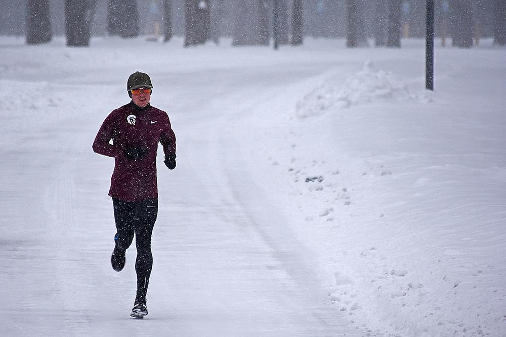 Andrew Payton, a member of the University of Arkansas at Little Rock cross country team, goes for a run around the UALR campus Wednesday. (Arkansas Democrat-Gazette/Staci Vandagriff)