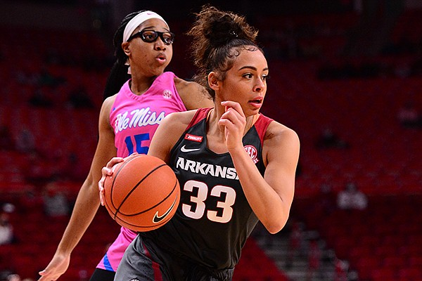 Arkansas guard Chelsea Dungee (33) dribbles the ball during a game against Ole Miss on Friday, Feb. 19, 2021, in Fayetteville.