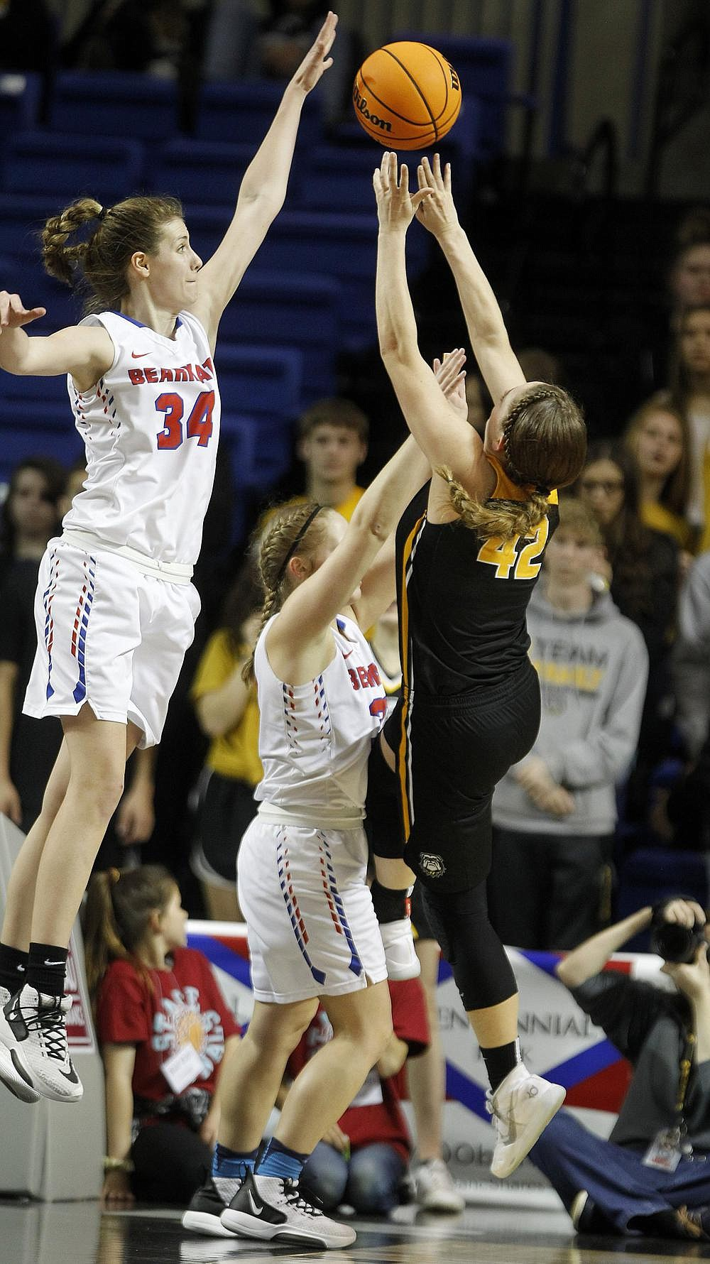 Melbourne's Jenna Lawrence (left) blocks a shot against Quitman in last season's Class 2A girls state championship game. The Lady Bearkatz's quest to repeat as champions was delayed after the Arkansas Activities Association announced Friday that regional tournaments, state tournaments and state finals are being pushed back a week because of inclement weather in the state.