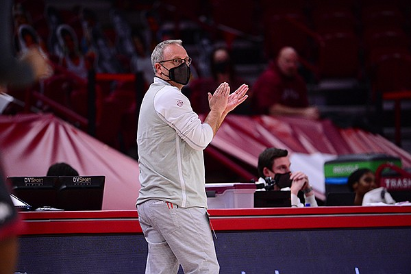Arkansas coach Mike Neighbors is shown during a game against Ole Miss on Friday, Feb. 19, 2021, in Fayetteville.