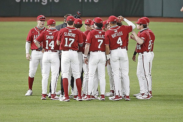 Arkansas players huddle prior to a game against Texas Tech on Saturday, Feb. 20, 2021, during the College Baseball Showdown at Globe Life Field in Arlington, Texas.