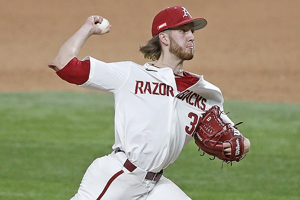 Arkansas pitcher Caleb Bolden throws during a game against Texas on Sunday, Feb. 21, 2021, in Arlington, Texas.