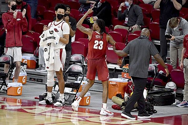 Alabama guard John Petty Jr. (23) gestures as he is escorted off the court after being ejected during the second half of the team's NCAA college basketball game against Arkansas in Fayetteville, Wednesday, Feb. 24, 2021. (AP Photo/Michael Woods)