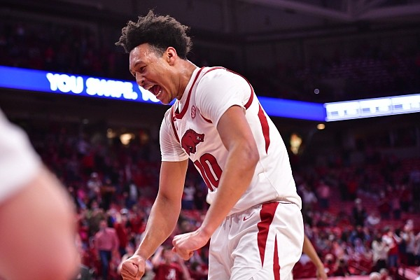 Arkansas forward Jaylin Williams celebrates following a play during a game against Alabama on Feb. 24, 2021, in Bud Walton Arena in Fayetteville.
