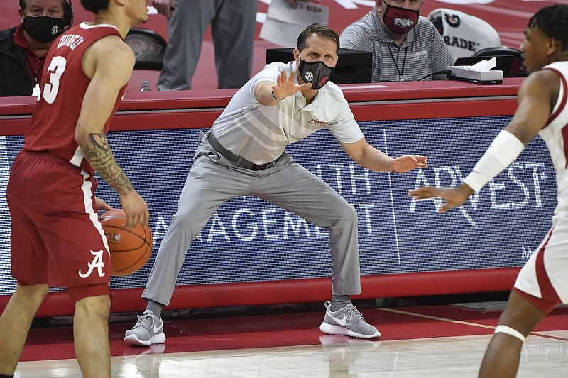 Arkansas coach Eric Musselman reacts to a play against Alabama during the first half of an NCAA college basketball game in Fayetteville, Ark. Wednesday, Feb. 24, 2021. (AP Photo/Michael Woods)