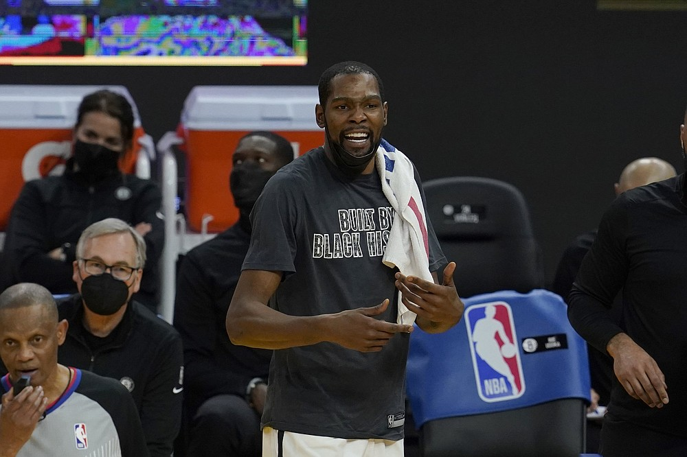 Brooklyn Nets forward Kevin Durant watches from the bench against the Golden State Warriors during an NBA basketball game in San Francisco, Saturday, Feb. 13, 2021. (AP Photo/Jeff Chiu)