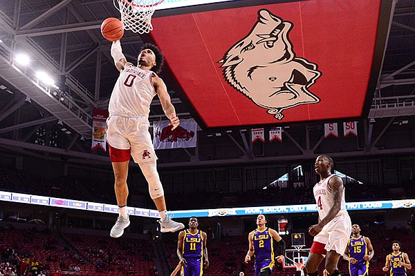 Arkansas' Justin Smith (0) dunks the ball during a game against LSU on Saturday, Feb. 27, 2021, in Fayetteville.