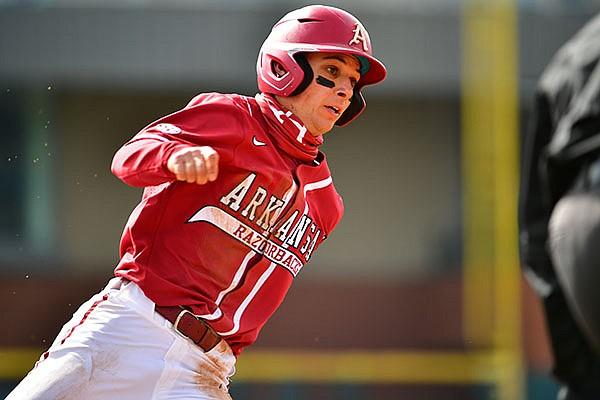 Arkansas' Robert Moore runs toward home plate during a game against Southeast Missouri State on Saturday, Feb. 27, 2021, in Fayetteville.