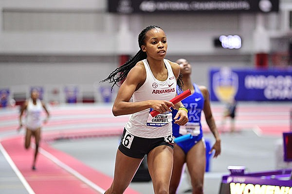 Arkansas' Kethlin Campbell runs the anchor leg of the mile relay during the SEC Indoor Championships on Saturday, Feb. 27, 2021, in Fayetteville.